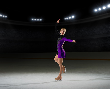 Young girl figure skater (on ice arena with spotlights ver)