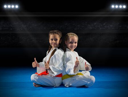 Girls martial arts fighter in sports hall
