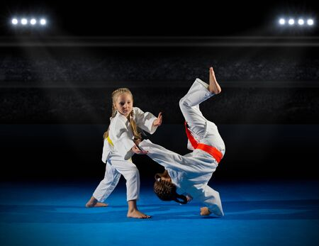 rostrum: Girls martial arts  fighters at sports hall