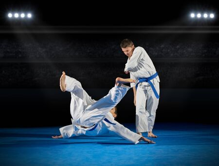 rostrum: Boys martial arts fighters in sports hall