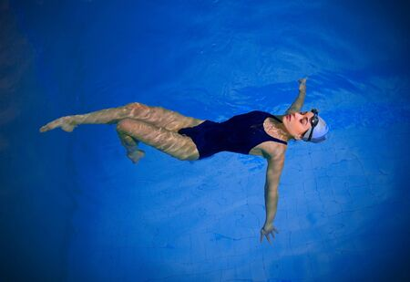 Young woman swimmer in pool Stock Photo