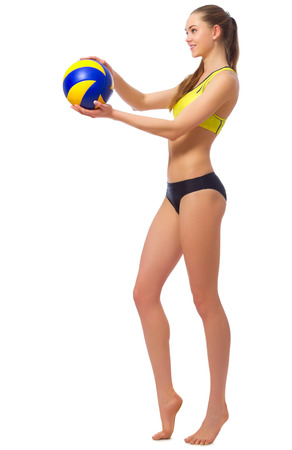 Young woman beach volleyball player isolated