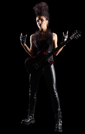 Young woman rock musician on black