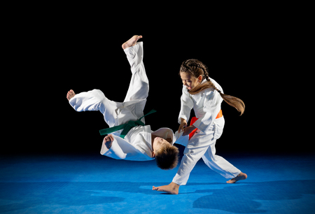 Little children martial arts fighters isolated