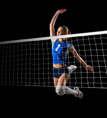 Young woman volleyball player (with net ver) Stock Photo