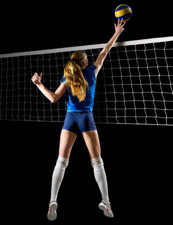 Young woman volleyball player (ver with ball and net)