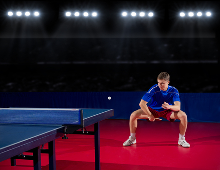 Young table tennis player in sports hall