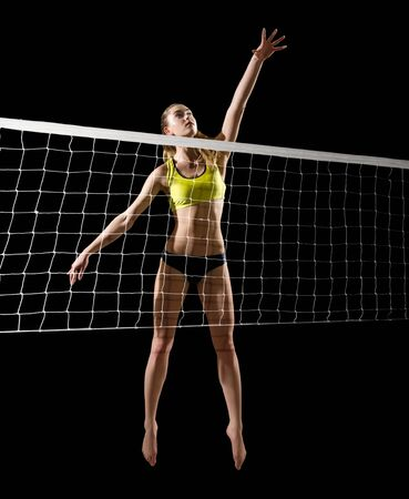 Young girl beach volleyball player (ver with net)