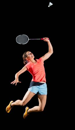 shuttlecock: Young woman badminton player isolated without net Stock Photo