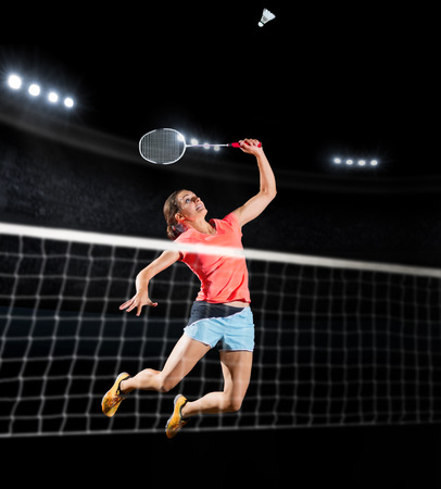 Young woman badminton player isolated sports hall Stok Fotoğraf