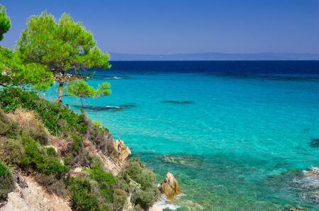 Blue sea shore under clear sky Stock Photo
