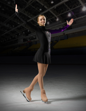rostrum: Young girl figure skater in sports hall