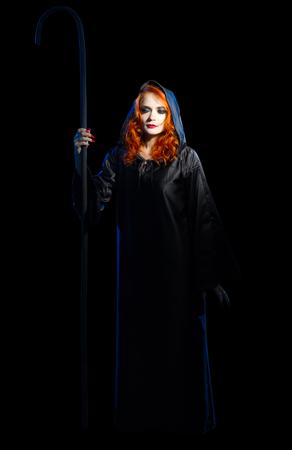 黒に分離された若い魔女 写真素材