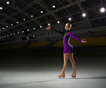 Young woman figure skater at sports hall Stock Photo - 89322428