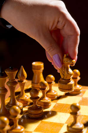 Chessboard with figures on dark background Stock Photo