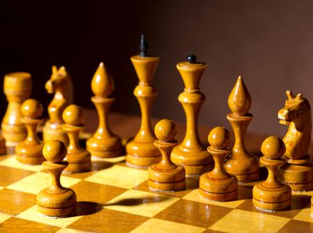 Chessboard with figures on dark background Stockfoto