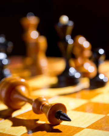 Chess pieces on playing board Stock Photo
