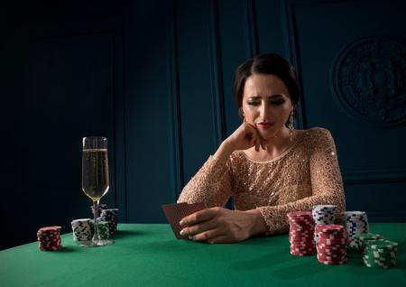 Beautiful woman playing in casino Stock Photo