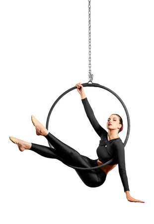 Young woman doing gymnastic exercises on the hoop isolated Stock Photo