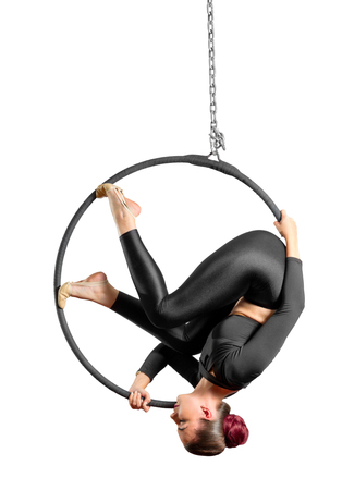 Young woman doing gymnastic exercises on the hoop