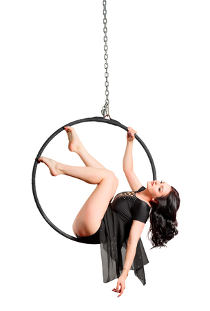 Young woman on gym hoop isolated