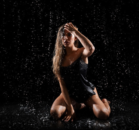 Young woman with water drops (color ver) Stock Photo