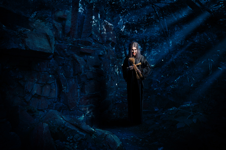 Scary witch in night forest Stock Photo