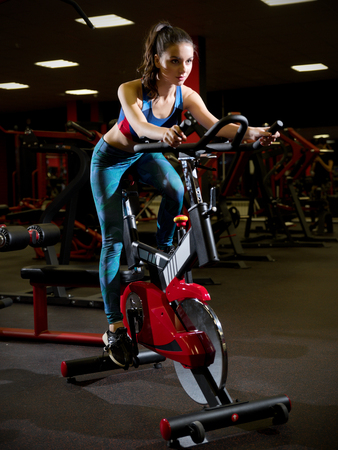 Young sporty woman in fitness club Reklamní fotografie
