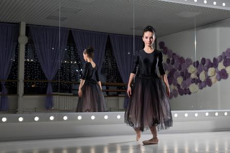 Young ballerina in training hall 免版税图像