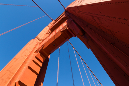 Golden Gate Bridge, San Francisco, California, tower against a bright blue sky looking up