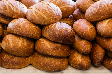 Fresh sourdough bread stacked in a bakery ready to sell and eat