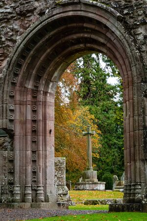 Moody soft light falls on Dryburgh Abbey ruins in the Borders area of Scotland, United Kingdom