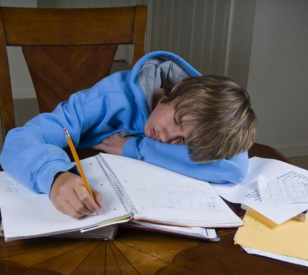 Teenager tired from doing homework