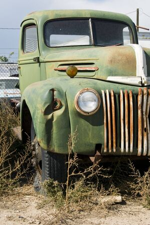 abandoned car: An old truck sitting in a junkyard