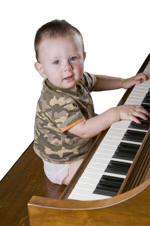 Gelukkig weinig genie spelen Chopin Stockfoto