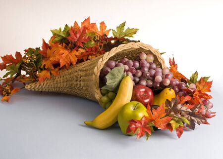 A horn shaped basket filled with colorful decorations