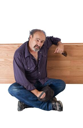 Drunk man leans on a wooden devider Stock Photo - 3726222