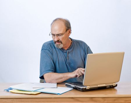 A businessman transcribes his notes onto the computer. Stock Photo - 3735264