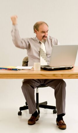 Businessman seated at a table with a laptop Stock Photo - 3747253