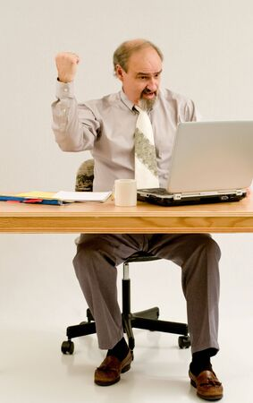 quarterly: A businessman likes the quarterly figures on his laptop