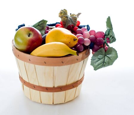 A small basket filled with various fruit photo