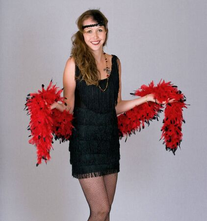 Flapper model with boa and fishnet stockings Stock Photo - 3824694