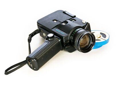 Super 8 movie camera and developed film. Stock Photo