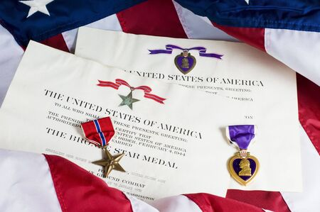 valor: American service awards given for combat valor and wounds.