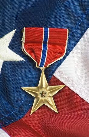 valor: Bronze star, awarded for valor in combat.