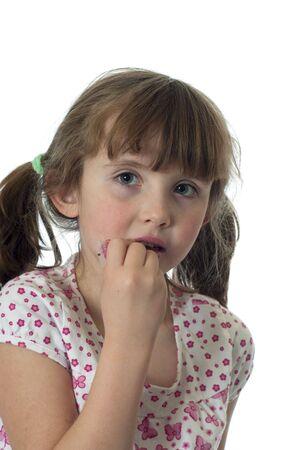 gloss: A little girl putting on lip gloss