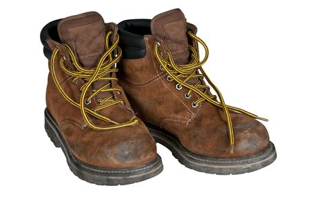 white work: A pair of mens work boots scuffed along the toes Stock Photo