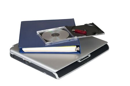 A laptop computer and cd plus flash memory isolated  photo