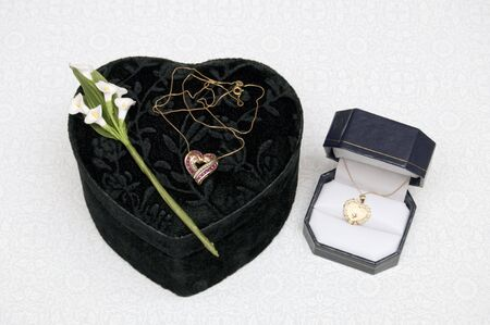 neckless: Gold chain and neckless with Rubies on black box Stock Photo