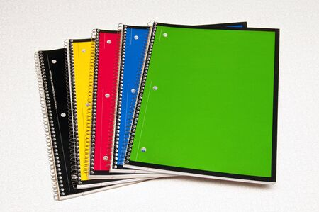 Five different colors of spiral bound  school notebooks Stock Photo - 4208991